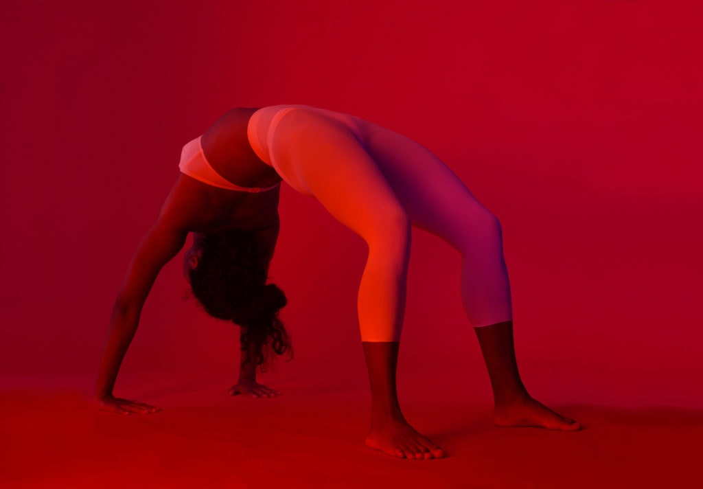 Yoga pose under red light at ChromaYoga in Shoreditch, London