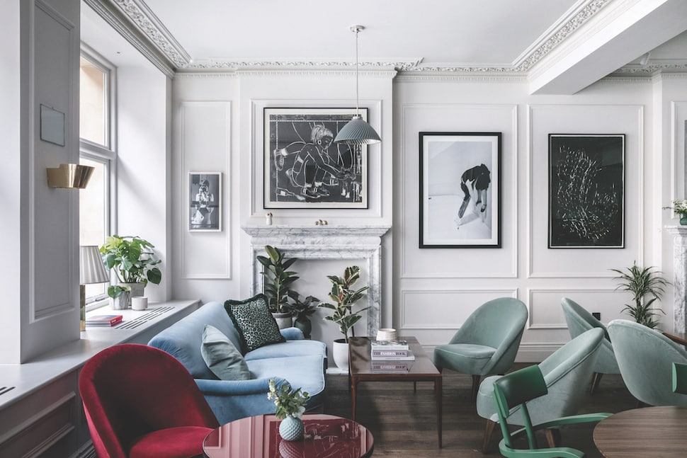 Velvet sofa and chairs in a seating area at AllBright Mayfair