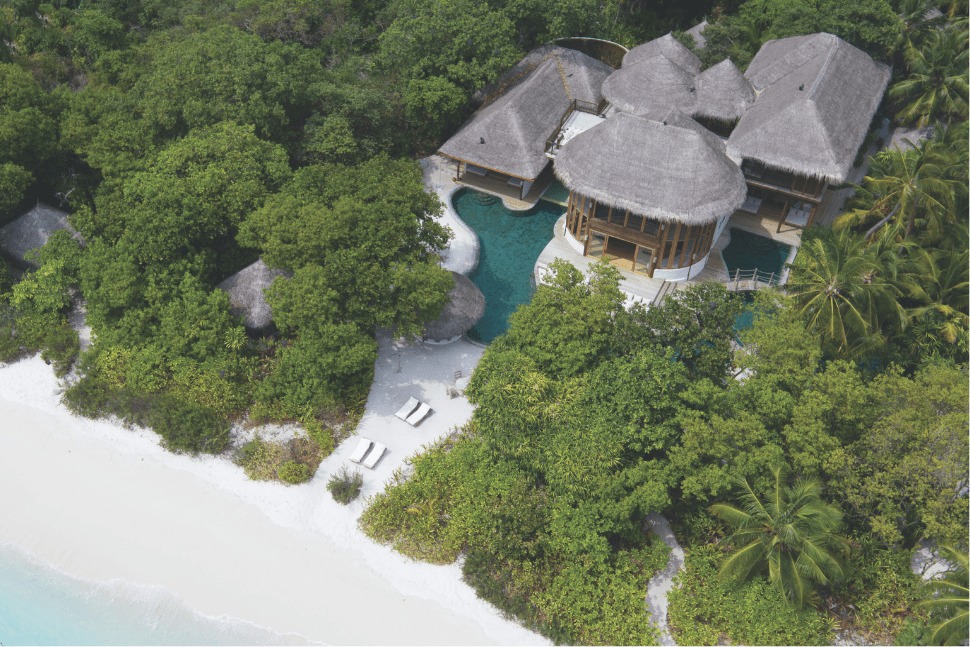 A birdseye view of the beachfront rooms at Soneva Fushi in the Maldives
