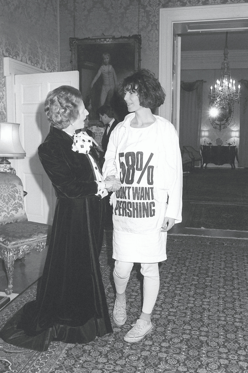 Katharine Hamnett meets Margaret Thatcher at a reception at 10 Downing Street wearing a T-shirt with a nuclear missile protest message