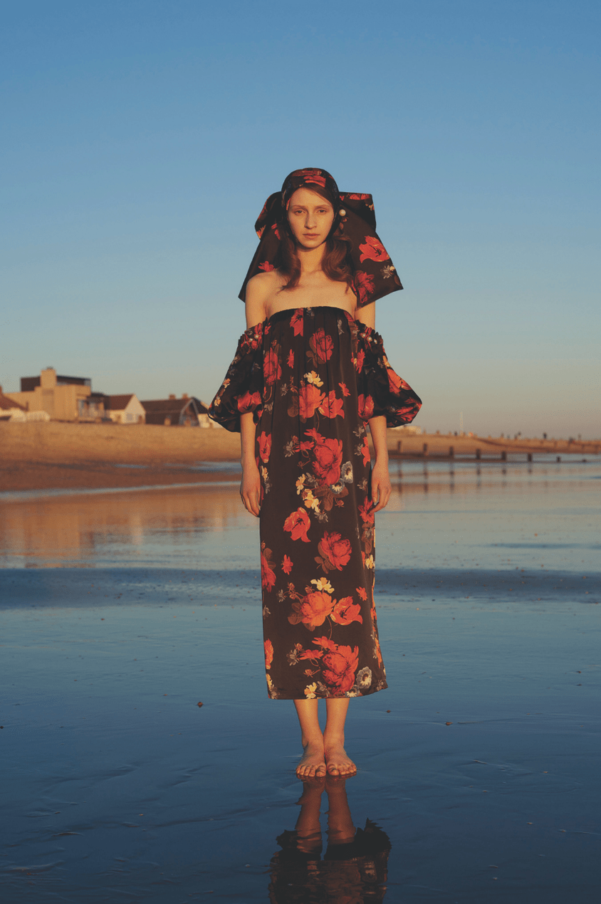 Model wears black and red floral off-the-shoulder dress and matching headscarf from the Mother of Pearl SS19 collection