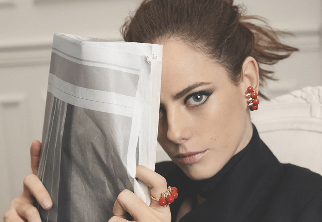 Model wears earrings and ring from the Clash de Cartier collection