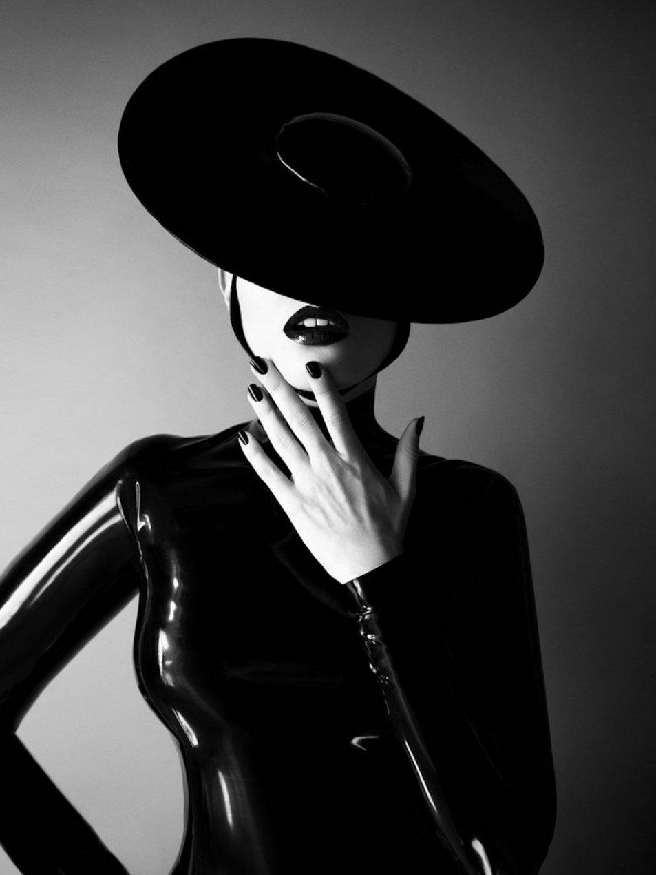 Charli Howard in black latex bodysuit and hat