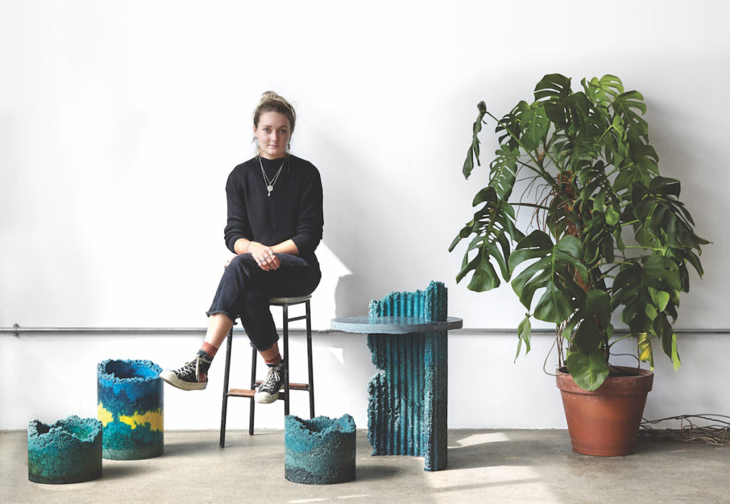 Designer Charlotte Kidger sits with items from her Industrial Craft collection
