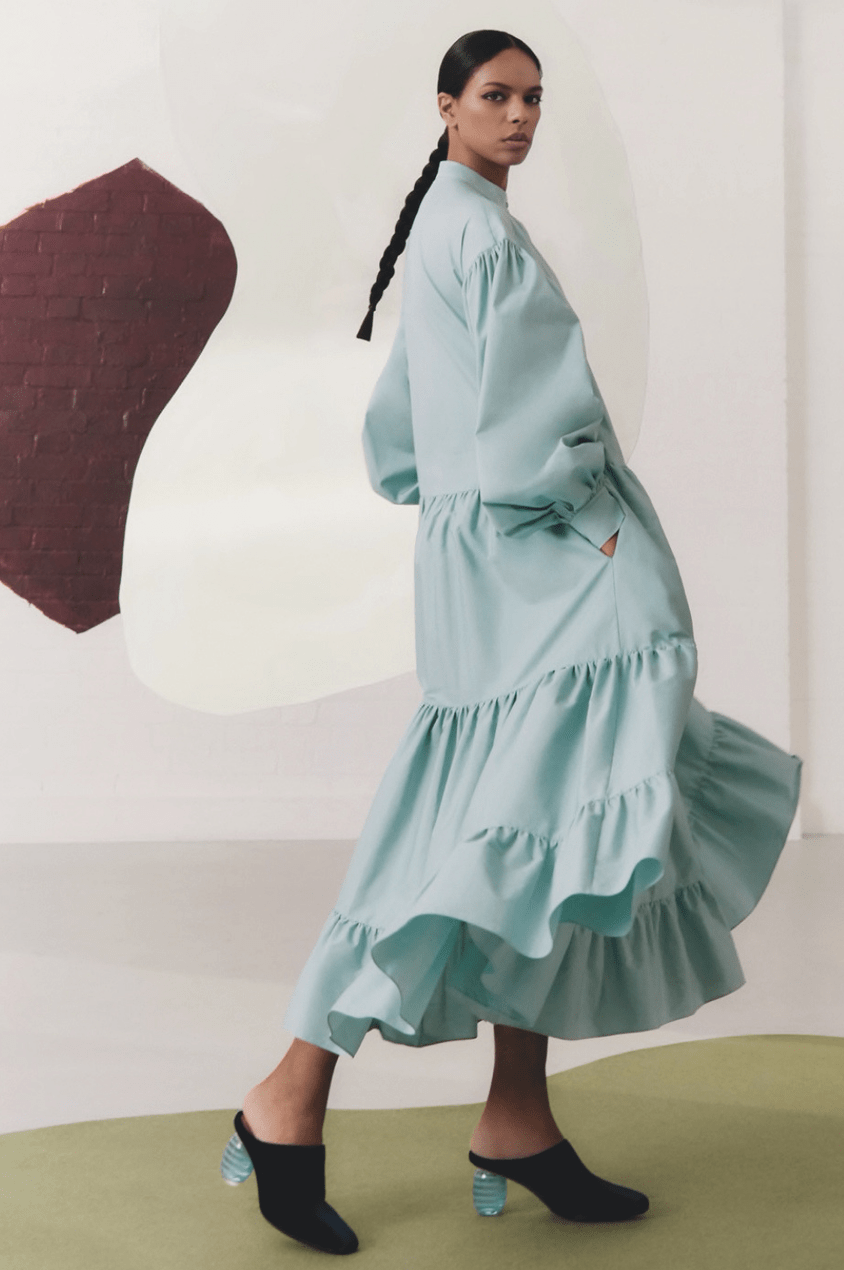Noëlla Coursaris Musunka models a blue tiered maxu dress from the Malaika and Roksanda collaboration with The Outnet
