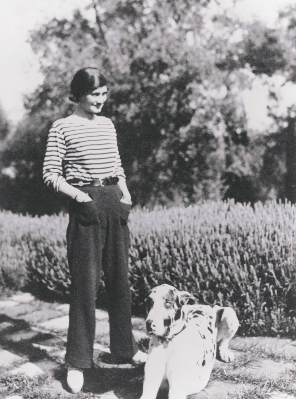 Mademoiselle Chanel at her house La Pausa in the French riviera with her dog Gigot in 1930