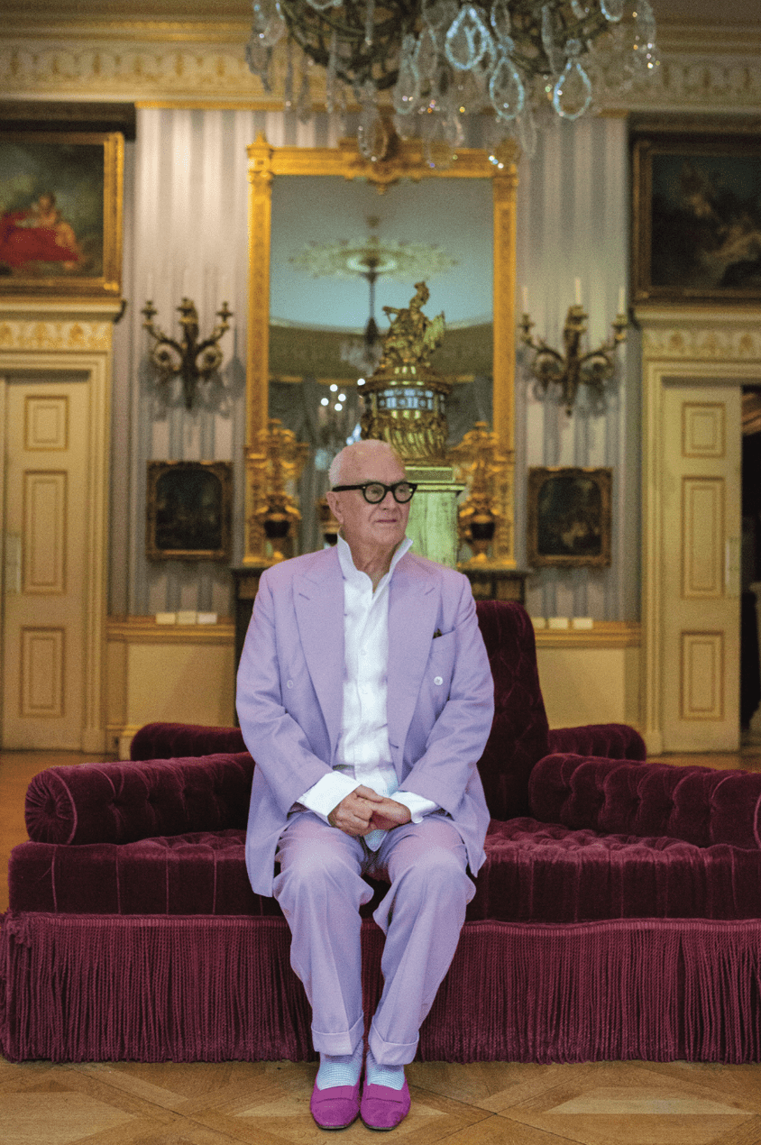 Manolo Blahnik in a lilac suit at The Wallace Collection in London