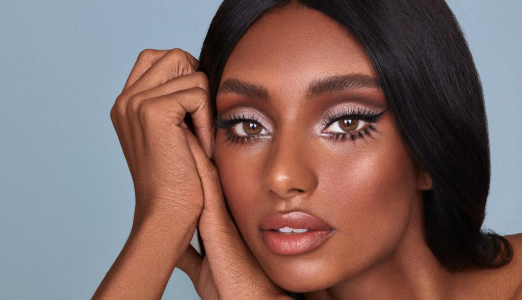 A model wears Nikki Wolff x Sweed-Lashes false eyelashes