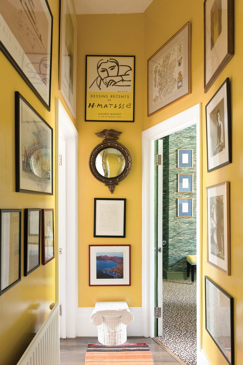 Luke Edward Hall's yellow hallway with floor to ceiling artwork