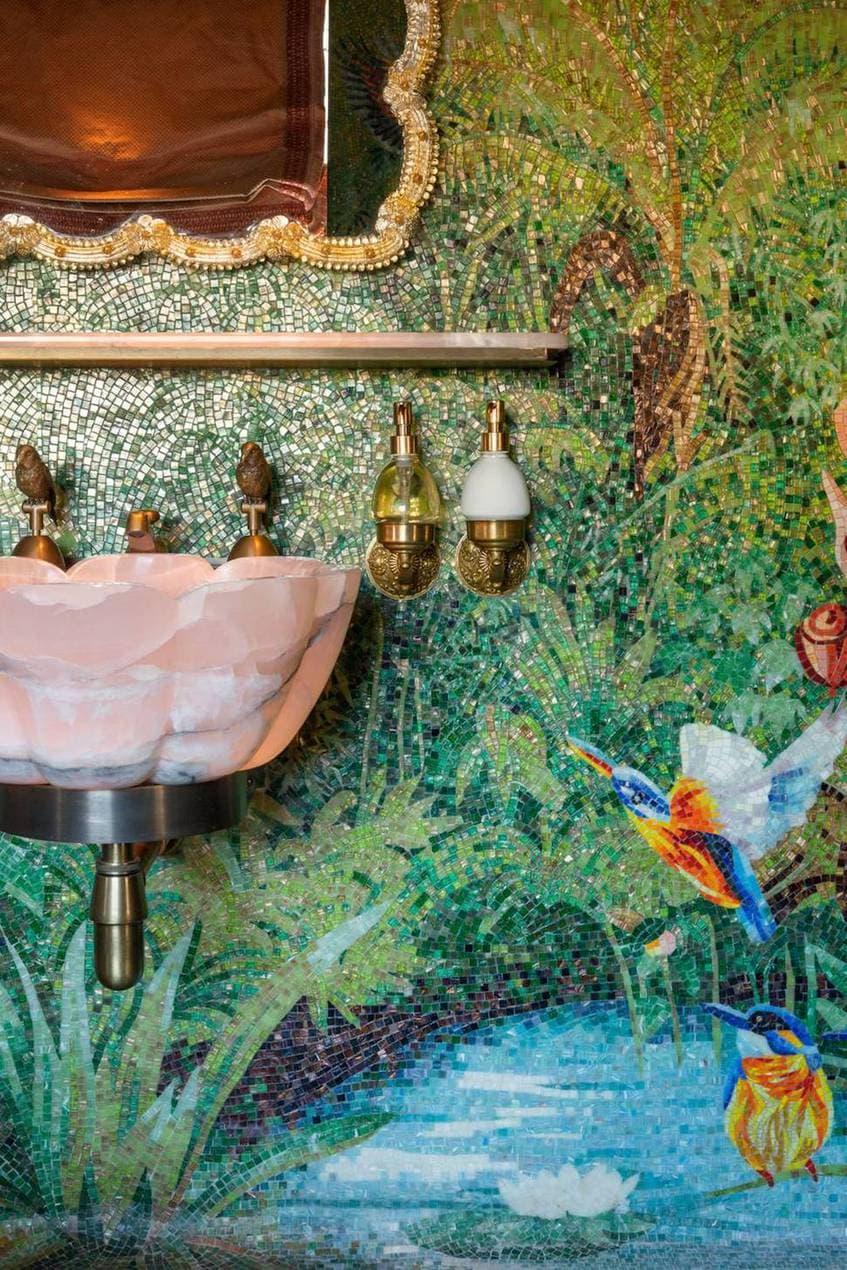 Pink sink and mosaic wall in Annabel's bathroom designed by Martin Brudnizki Design Studio