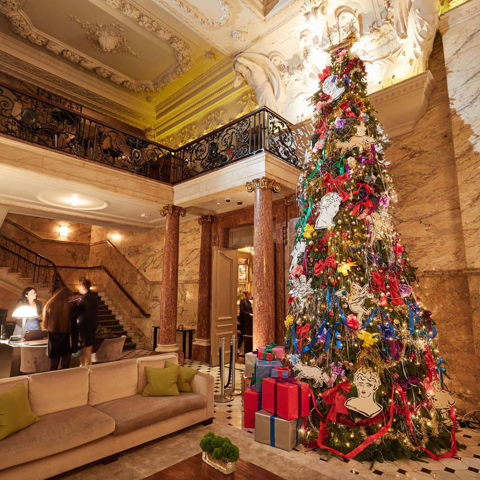 The Christmas tree decorated by British artist and interior designer Luke Edward Hall in the lobby of The London EDITION