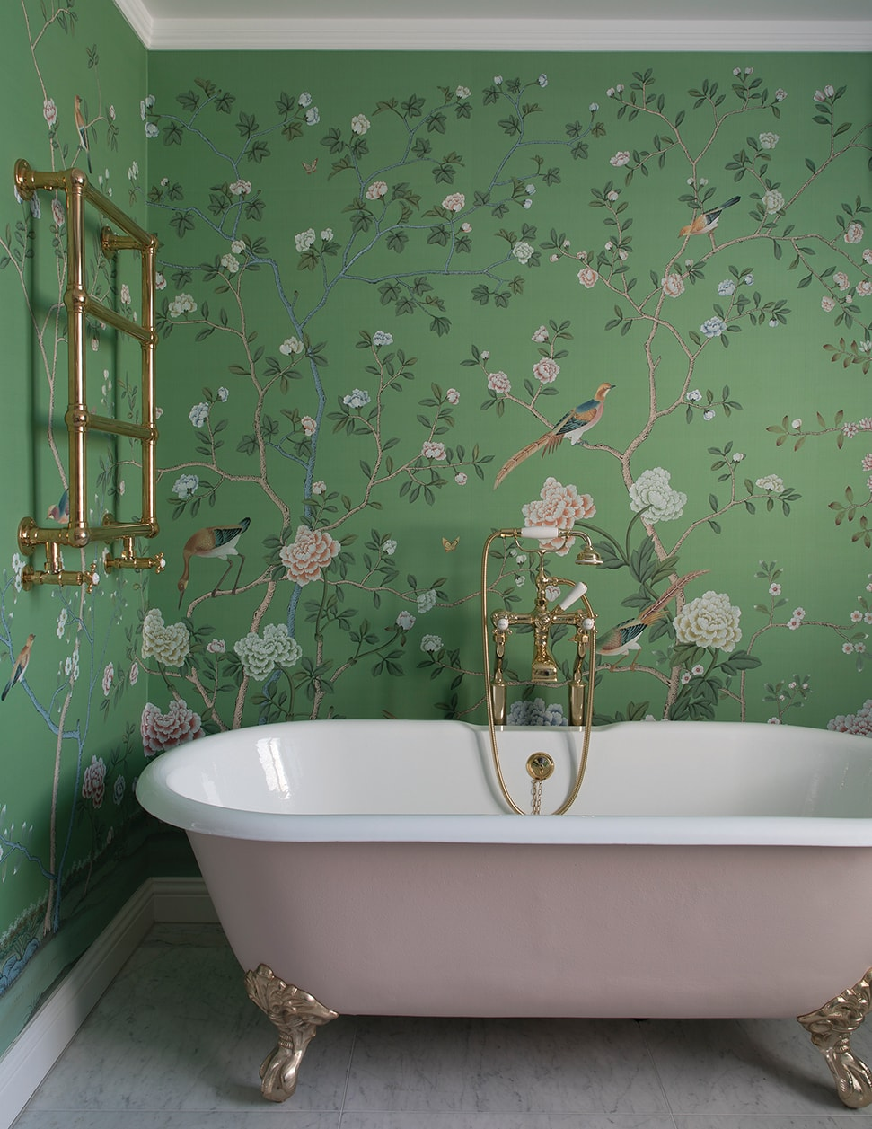 The master bathroom with pink tub and De Gournay wallpaper