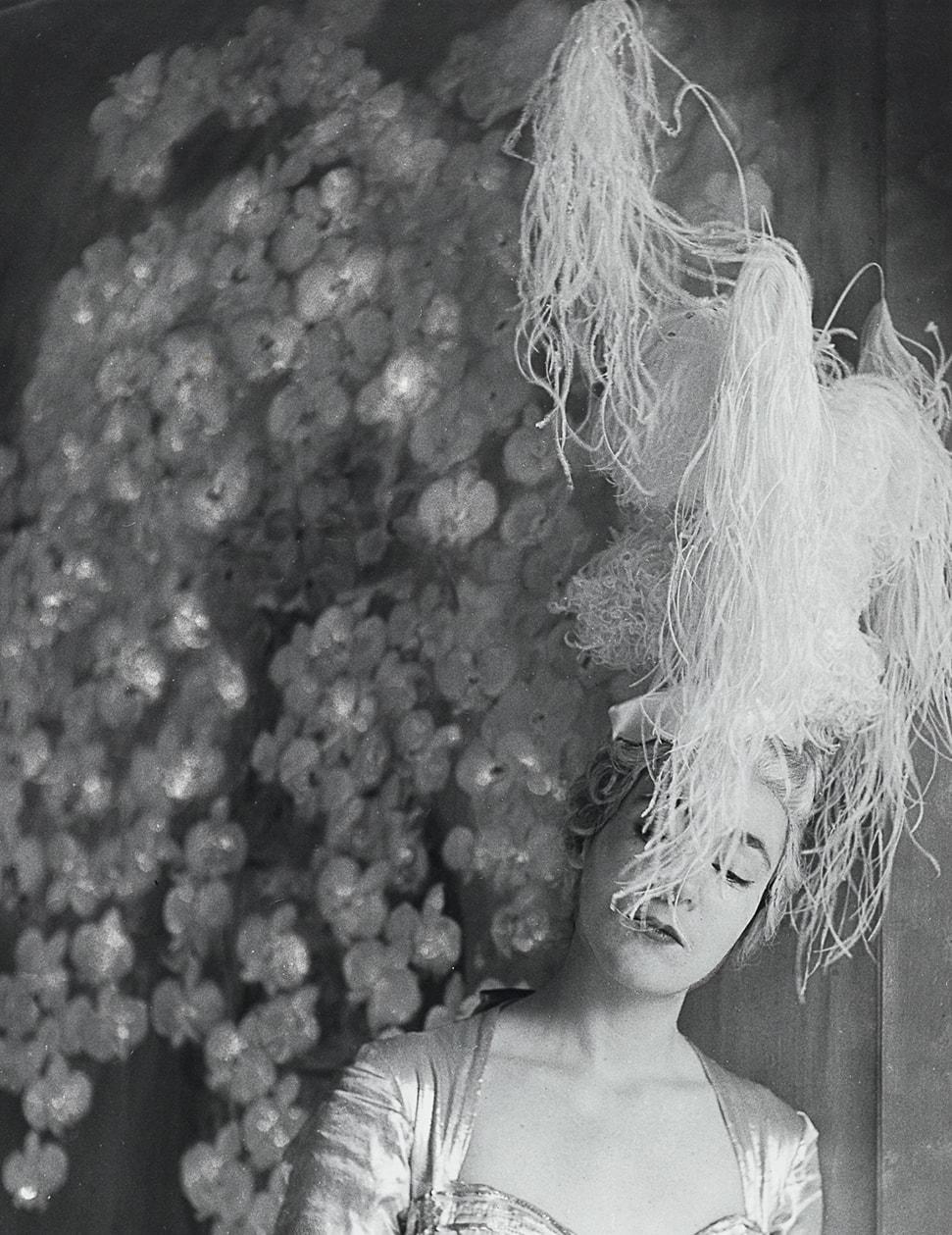 Elizabeth Strong-Cuevas in a costume by Pierre Balmain for her father's party, 1953, Madame d'Ora (Dora Kallmus) (1881–1963) / Museum für Kunst und Gewerbe Hamburg. Photo: © Nachlass Madame d'Ora, Museum für Kunst und Gewerbe Hamburg