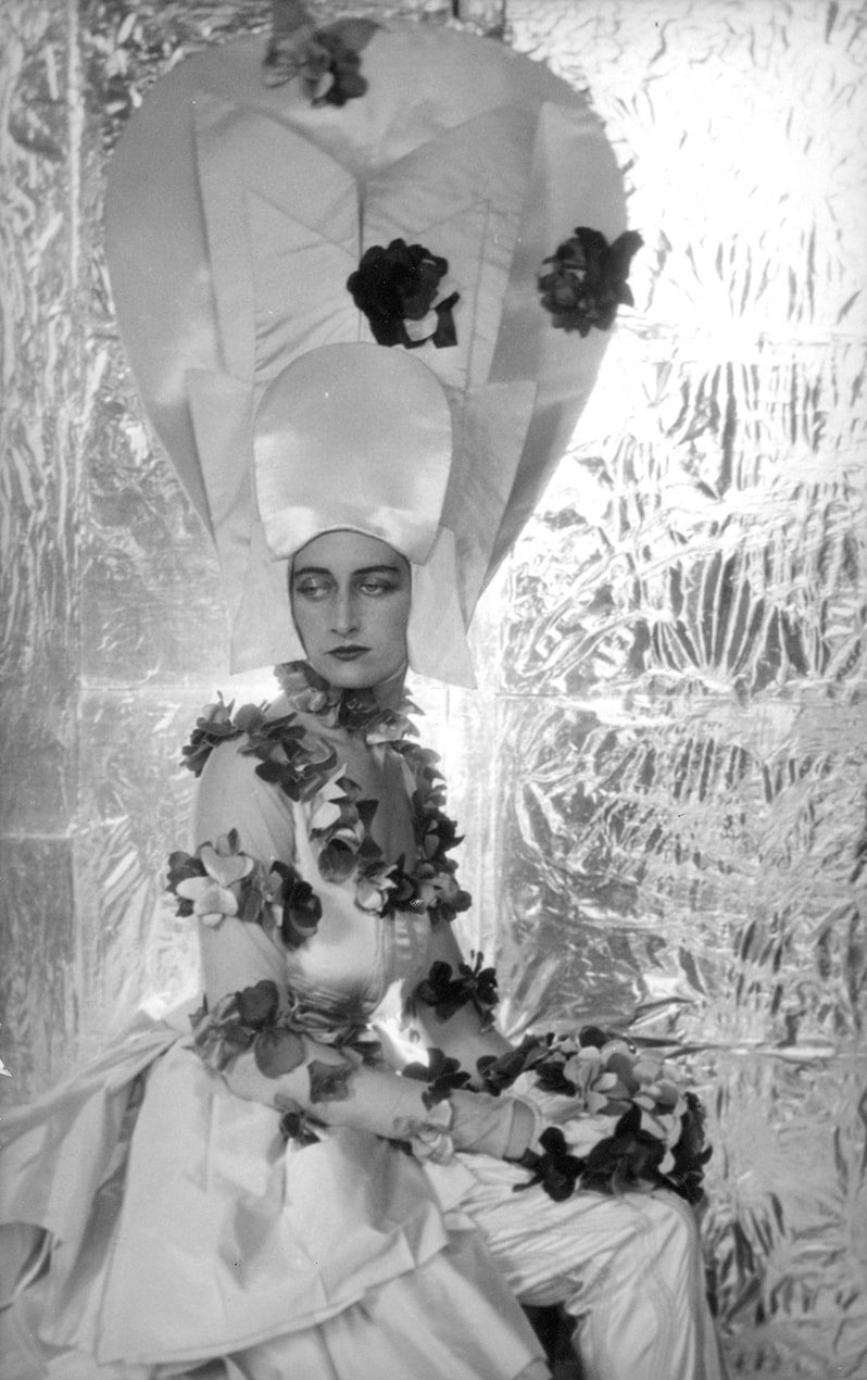 Maxine Freeman-Thomas dressed for Ascot in the year 2000 for the Dream of Fair Women Ball by Cecil Beaton, 1928. © The Cecil Beaton Studio Archive