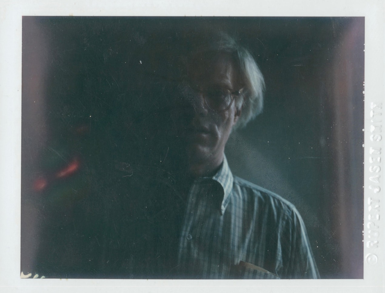 A self-portrait photograph of pop artist Andy Warhol