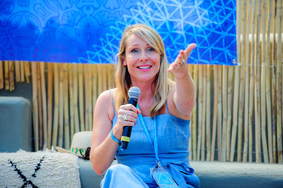 Sustainable travel expert Juliet Kinsman speaking at an event