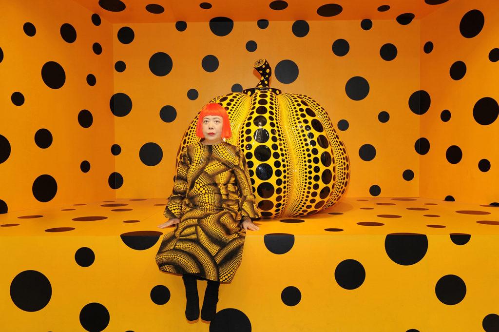The artist Yayoi Kusama with one of her pumpkins