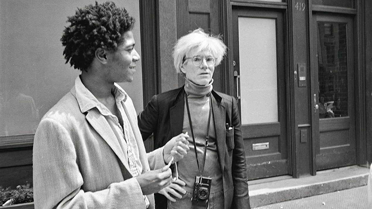 Messrs Andy Warhol and Jean Michel Basquiat outside the Mary Boone Gallery on West Broadway 3 May 1984. Photograph © The Andy Warhol Foundation for the Visual Arts Inc. Courtesy of Taschen