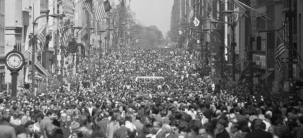 A black and white photograph from the first Earth Day in 1970, where 20 million people attended