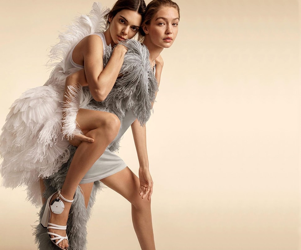 Kendell Jenner and Gigi Hadid wear feathered dresses by British label Burberry, who have made their runway playlists available online